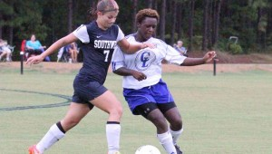 DAILY LEADER / NATALIE DAVIS / Co-Lin defender Casherry Russell battles Southwest Krystal Chailland for possession of the ball Friday at Wesson.