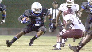 DAILY LEADER / JONATHON ALFORD / Co-Lin defensive back Kalen Jackson (6) returns a fumble recovery for positive yards for the Wolfpack as Hinds wide receiver Desmond Anderson (13) prepares to defend the play Thursday night at Stone Stadium.