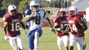DAILY LEADER / NATALIE DAVIS / Co-Lin's Casey Gladney (8) outruns Jones County's D'Andre Jackson (16), Charles Lewis (17) and Marcus Betts (14). Gladney had 10 catches for 168 yards and four touchdowns.