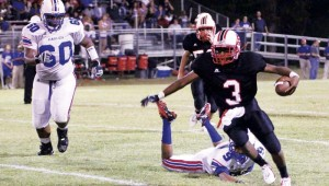 DAILY LEADER / AMY RHOADS / Loyd Star running back Zacchaeus Arnold (3) sweeps to the outside to gain some positive yards against the North Forrest Eagles Friday night.