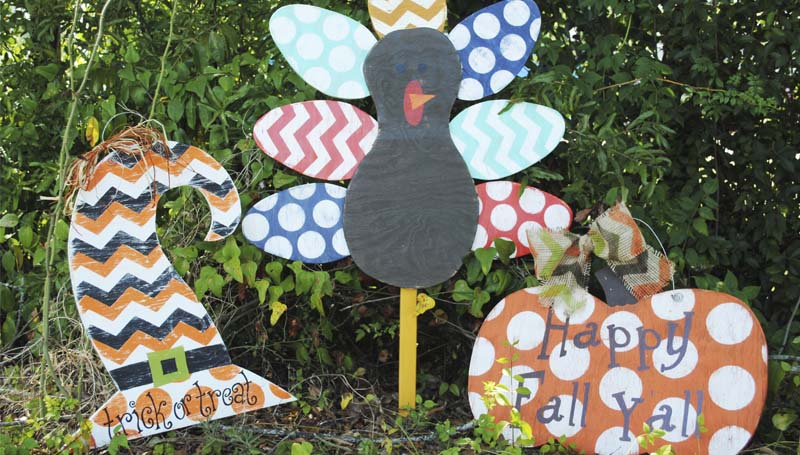 DAILY LEADER / JESSICA BOYD / Local business Two Sisters and Brush make many wooden decorations, including fun door hangers and colorful yard art for fall.