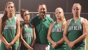 """DAILY LEADER / MARTY ALBRIGHT / West Lincoln recognized their seniors (from left) Heather Moak, Karley """"Squishy"""" Smith, Coach Andrew Redd, Destiny Allen and Bentley Sills Monday night."""