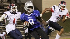 DAILY LEADER / NATALIE DAVIS / Co-Lin wide receiver Casey Gladneyu (8) gets away from Itawamba defenders Stanley Childs (4) and Wesley Bailey (7) Thursday night in Stone Stadium.