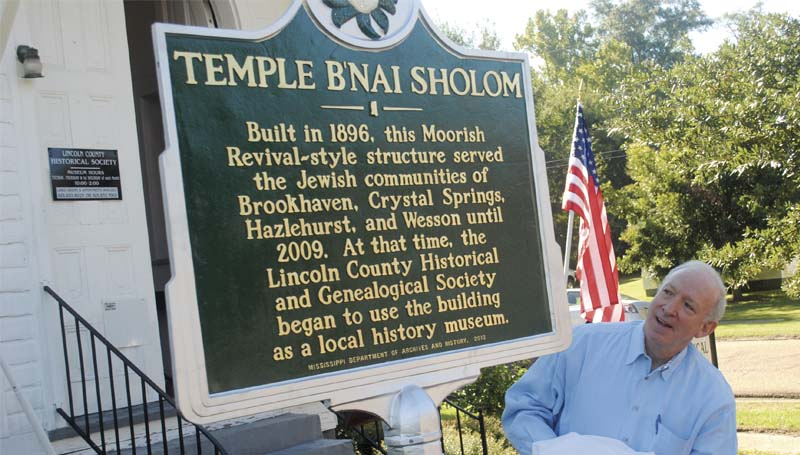 DAILY LEADER / JUSTIN VICORY / Hal Samuels unveils a new historic marker for the B'nai Shalom Temple in front of the Lincoln County Historical and Genealogical Museum Wednesday.