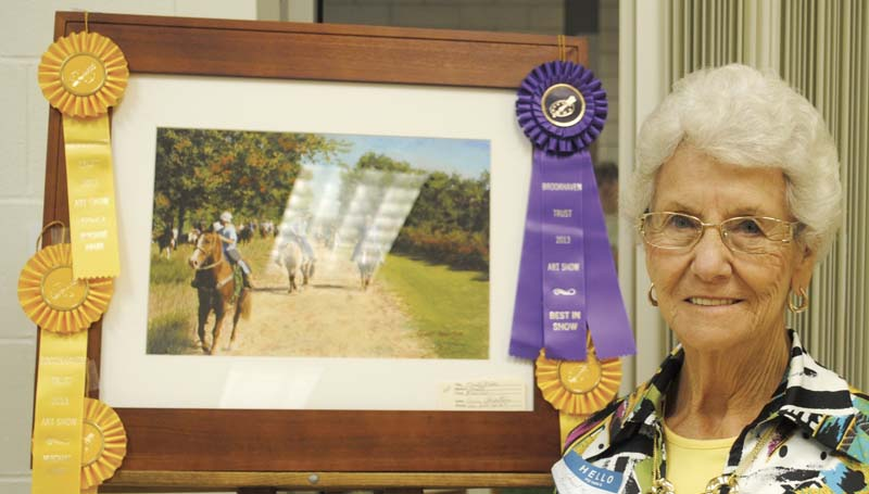 """DAILY LEADER / JUSTIN VICORY / Gwin Robertson stands next to her painting, """"Trail Ride,"""" which won five separate awards in the Brookhaven Trust Fine Arts Committee's art competition Thursday, including Best of Show."""