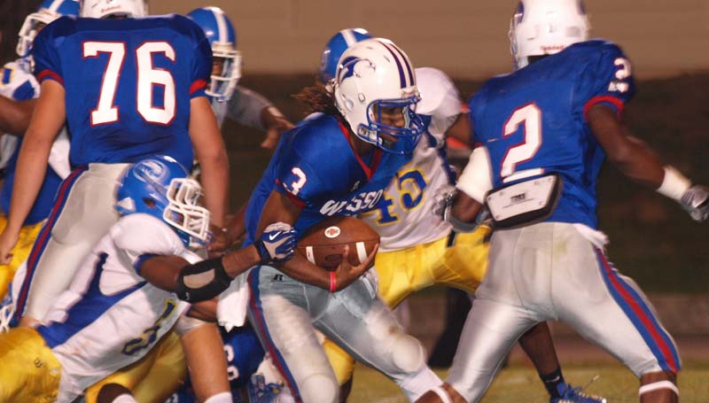 DAILY LEADER / TRACY FISCHER / Wesson Tyler Christmas (3) sprints up the field for a big gain as teammate Michael Hauer prepares to make a block on Crystal Springs at Stone Stadium.