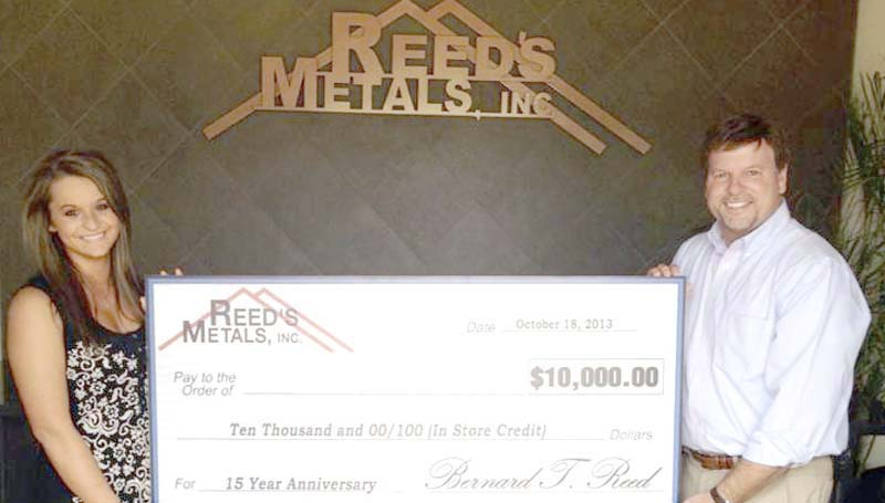 PHOTO SUBMITTED / Bernie Reed (right), owner and CEO of Reed's Metals, and employee Laina Watts showcase the grand prize of $10,000 in-store credit to be given away on Friday, Oct. 18, in honor of Reed's Metals 15th anniversary.