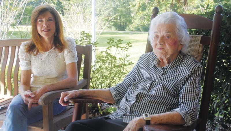 DAILY LEADER JUSTIN VICORY / Evelyn Davis (right) concludes a visit with friends at the Haven Hall Nursing Center Saturday and pauses to enjoy the autumn breeze with her daughter, Kathy Walker.