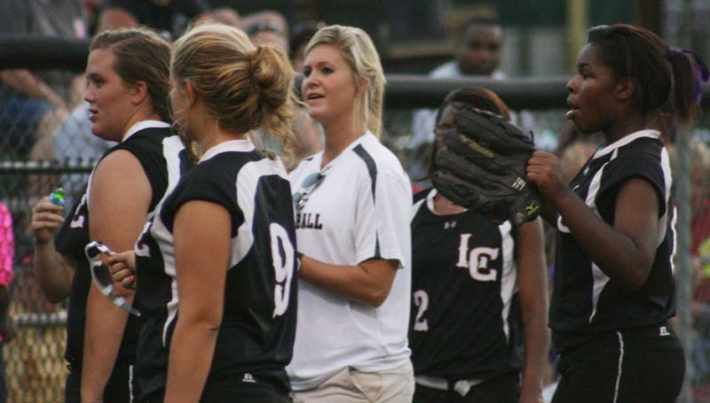 DAILY LEADER / MARTY ALBRIGHT / Coach Meleah Howard (center) and her Lawrence County Lady Cougars are excited to start their march in the state slowpitch softball playoffs today. The Lady Cougar hosts the Poplarville Lady Hornets. Game time is 5 p.m. in Monticello.