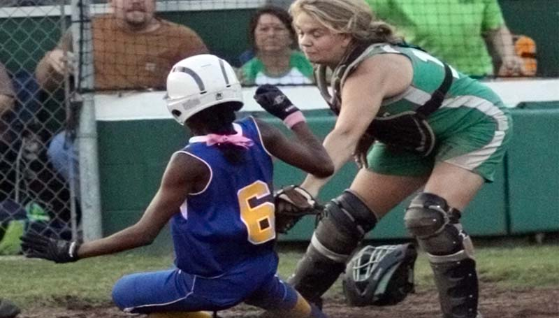 DAILY LEADER / TERESA ALLRED / West Lincoln catcher Hanna Moak (right) applies the tag on the Bay Springs runner Rashana Jones at home plate for the out Tuesday night.