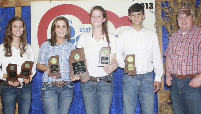 PHOTO SUBMITTED / First place 4-H Livestock Judging Team members include (from left) Rachel McDaniel (also third high individual), Sara Terrell, Mackenzie Ritchie, Brant White and Brandon Alberson, Extension agent/coach.