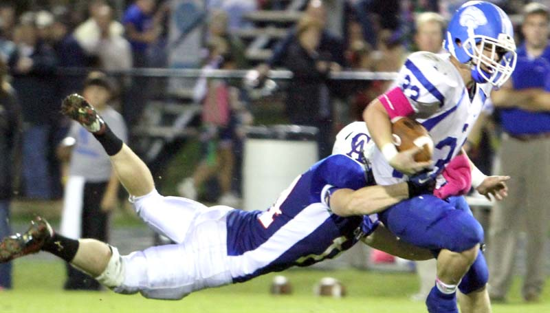 DAILY LEADER / SHERYLYN EVANS / Brookhaven Academy senior running back Landon Nettles (33) carries the ball and Copiah Academy defender Thomas Roberson for extra yard Friday night.