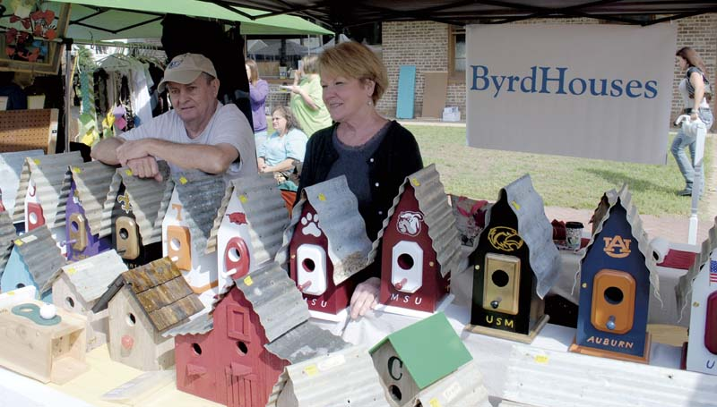 DAILY LEADER / JUSTIN VICORY / Jimmy and Jenie Byrd sell homemade birdhouses at the Wesson Flea Market Saturday. They were among more than 100 vendors at the event.
