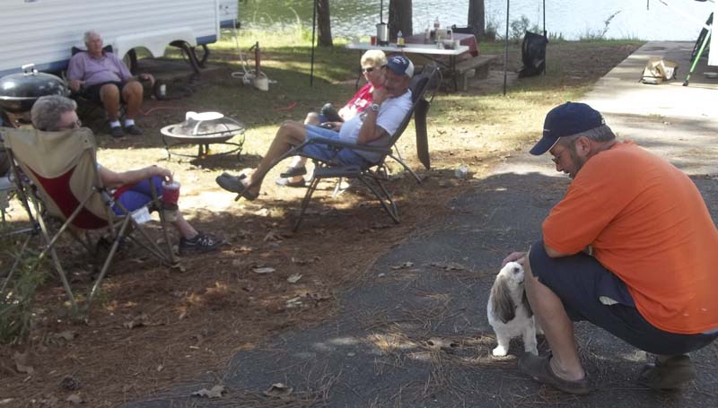 DAILY LEADER / KIM HENDERSON / Daisy, a Shih-Tzu, her owners and their friends, all of Byram, enjoy the fall weather at their campsite at Lake Lincoln recently.