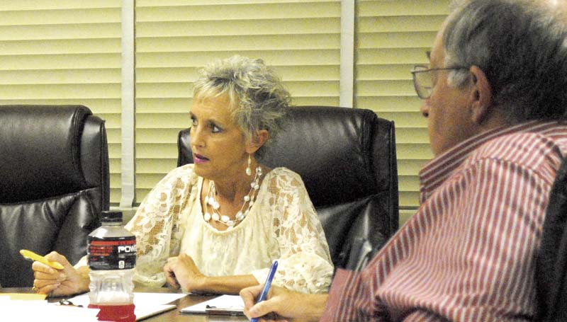 DAILY LEADER / JUSTIN VICORY / Assistant Superintendent Letha Presley, filling in for Superintendent Terry Brister, considers agenda items at Monday night's Lincoln County School Board meeting.