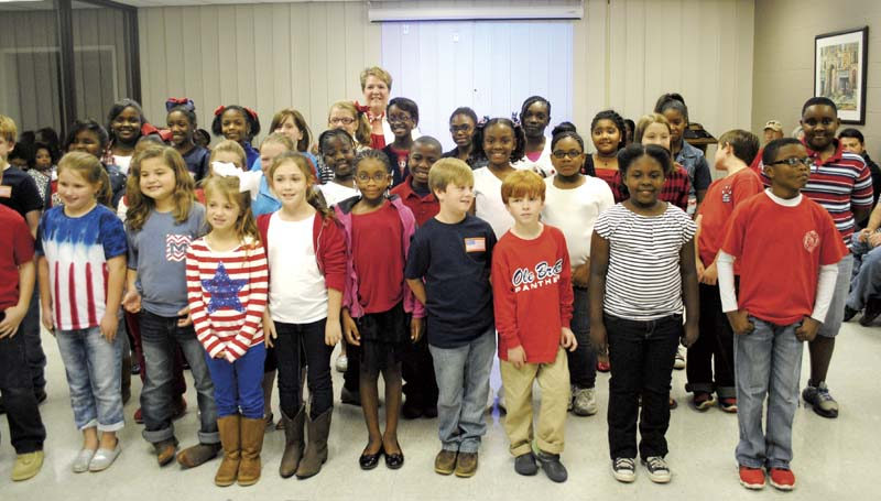 DAILY LEADER / JUSTIN VICORY / Students from Brookhaven Elementary School dress up in red, white and blue and sing patriotic songs to open Tuesday night's school board meeting.