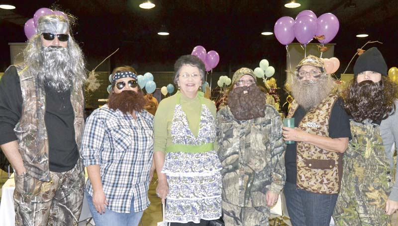 """In addition to the silent and live auctions Monday night at the BARL fund raiser , local business persons, professionals and officials dressed up for the evening as """"celebrities"""" to help with the dinner service and to earn tips for BARL. Among the """"celebrity"""" wait persons were characters from the TV show, """"Duck Dynasty,"""" portrayed by (from left) Mayor Joe Cox, Samantha Melancon, Patsy Walker, Brenda Smith, Cindy Smith and Holly Slay."""