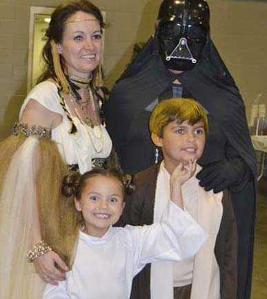 Dr. Ryan Case and wife Wendi and children, Olivia and Corey Case, portray the adult and child-age versions of the Star Wars characters at the BARL event.