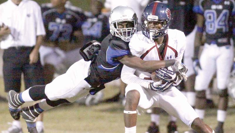 DAILY LEADER / JONATHON ALFORD / Co-Lin sophomore defender Greg Sims leaps to make a tackle on Southwest receiver Bodarius Johnson Thursday night at Stone Stadium.