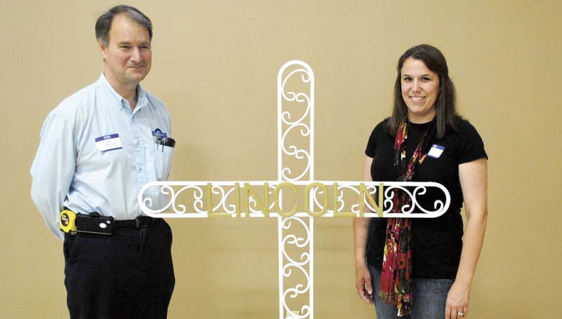 DAILY LEADER / JUSTIN VICORY / Displaying the Brookhaven Mission Mississippi group's cross this week are (from left) James Minter, cross designer and artist, and Laura Ann Walker, who will be playing a supervisory role at the statewide Mission Mississippi event coming up in Jackson Sunday, Oct. 27.