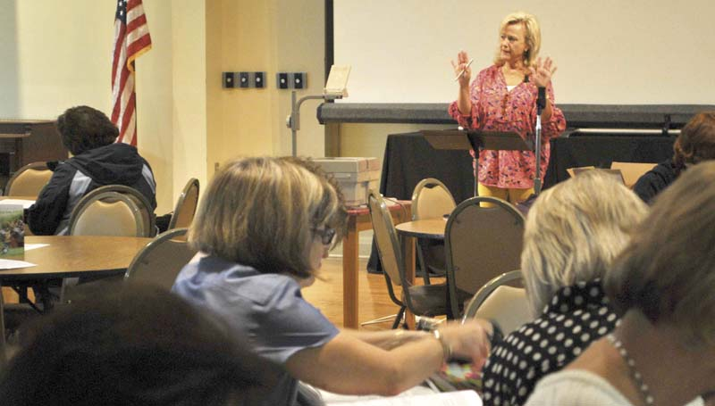 DAILY LEADER / KIM HENDERSON / Brookhaven's Theresa Sones speaks to a crowd of more than 100 women at a recent Bible study at First Baptist Church. Popular with both old and young attendees, the teacher has been leading the Thursday morning group for nearly 25 years.