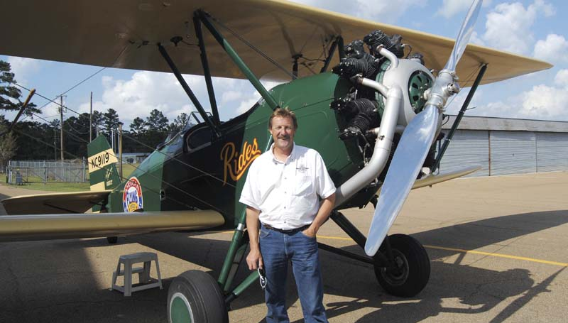 Ted Davis stands with his 1929 New Standard Biplane Monday.