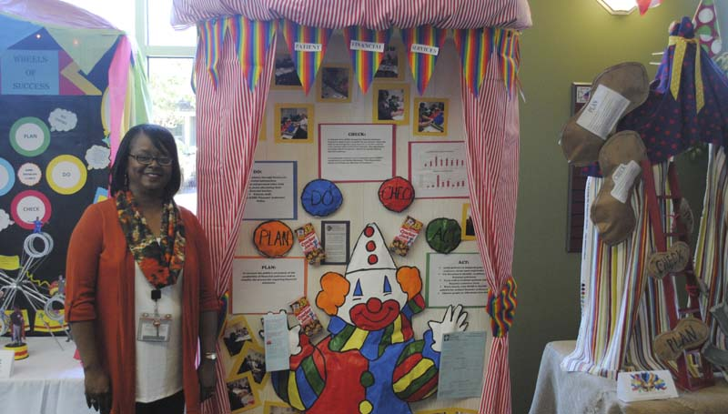 DAILY LEADER / JUSTIN VICORY / Showing off this year's performance improvement first prize-winning display created by the financial services department of King's Daughters Medical Center is Merida Johnson, RN, MSN and CPHQ at KDMC.
