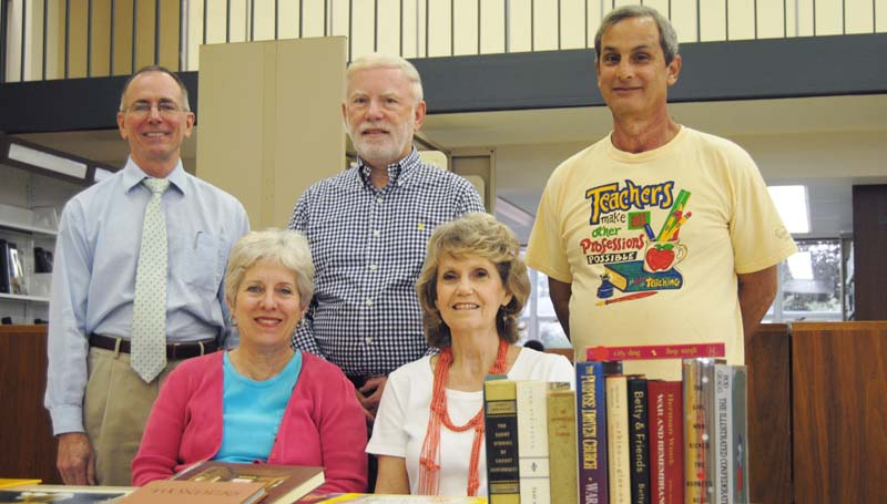DAILY LEADER / TAMMIE BREWER / Friends of Lincoln County Public Library are urging the public to come by and check out their Holiday Book Sale at the library beginning Friday and continuing through Saturday, Nov. 16. Helping out with book sale details are Library Director Henry Ledet (back, from left), Friends Vice President David Holland, Friends volunteer Eric Kaplan; Friends President Pam Womack (seated) and Friends Secretary Katherine Bumgarner.