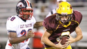 DAILY LEADER / JONATHON ALFORD / Enterprise quarterback Austin Coleman tries to escape East Marion's tackler Walter Moses to gain some yards Friday night at Harry Cole Field.