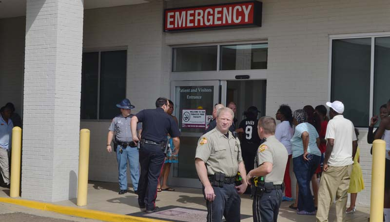 DAILY LEADER / RACHEL EIDE / Law enforcement officers gather at the King's Daughters Medical Center emergency room Sunday afternoon to help with crowd control after a shooting victim was brought to the hospital by ambulance. The victim, who was an innocent bystander to a shooting at the corner of Monticello Street and Martin Luther King Drive, was later transferred to Jackson for treatment Sunday afternoon, but has since been released from the hospital.