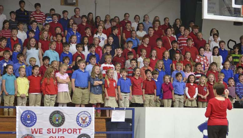 DAILY LEADER / RACHEL EIDE / Brookhaven Academy first through sixth graders sing a medley of the armed forces anthems during Monday's Veterans Day program at BA.