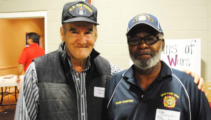 DAILY LEADER / JUSTIN VICORY / Veterans Ronald Nott and Edler Thompson share remembrances of their shared service Monday night at the Lincoln Civic Center Veterans Day program.