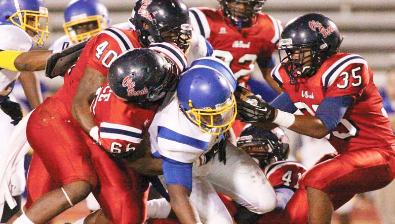 DAILY LEADER / JONATHON ALFORD / Brookhaven defensive tackles Leo Lewis (40), Dedric Smith (35) and Marquis Price (66) overpower Wingfield's running back Friday night at King Field.