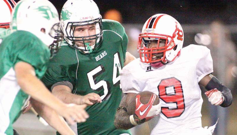 DAILY LEADER / JONATHON ALFORD / Loyd Star running back La'Treall (9) looks for some running room as West Lincoln defenders Sloan Nations (80) and Luke Barrilleaux (54) hustle in for the tackle Friday night at Perry Miller Field.
