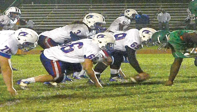 DAILY LEADER / TAMMY CARRAWAY / Wesson quarterback Tyler Christmas (3) calls out the play to his linemen, Chase Twiner (76), Justin Boone (66) and Josh Francois (69), against Wilkinson County Friday night.