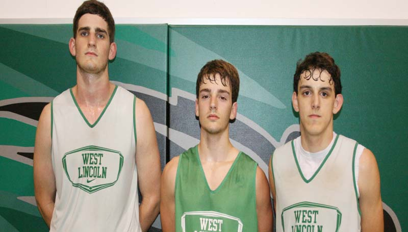 DAILY LEADER / MARTY ALBRIGHT / West Lincoln seniors (from left) Sam Bivens, Sid Griffin and Chase Buckles are excited to begin their 2013-14 basketball season.