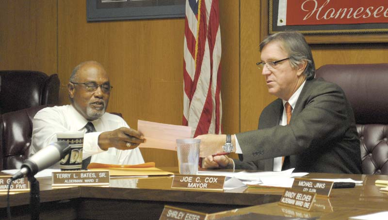 DAILY LEADER / JUSTIN VICORY / Ward Two Alderman Terry Bates and Mayor Joe Cox look over items on Tuesday night's board of aldermen meeting agenda.