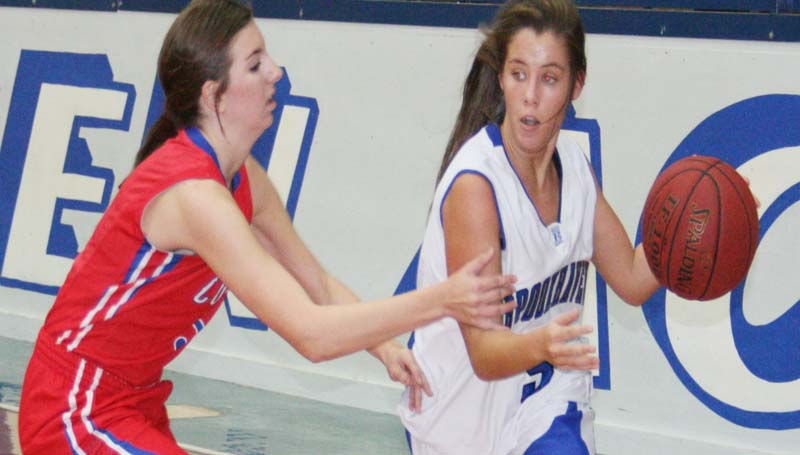 DAILY LEADER / MARTY ALBRIGHT / Brookhaven Academy's guard Madison Warren (right) drives past Copiah Academy defender Tuesday night.
