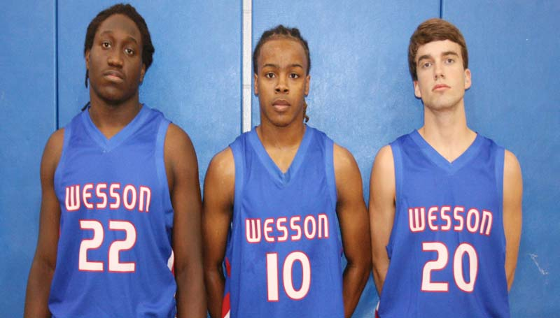 DAILY LEADER / MARTY ALBRIGHT / Representing the Wesson Cobras in the 2013-14-basketball season are seniors (from left) Nick Lewis, Marquis Lofton and Tanner Allen.