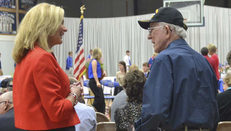 DAILY LEADER / RACHEL EIDE / Mississippi State Treasurer Lynn Fitch (from left) talks with veteran Joe Speights following Monday morning's Veterans Day program at Brookhaven Academy. Fitch was the keynote speaker for the event.