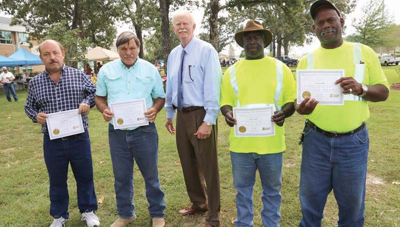 PHOTO SUBMITTED / The Mississippi Department of Transportation's District 7 recently held the annual Service Awards and Recognitions Program in McComb. The following MDOT employees were recognized for their 30 years with the agency (from left) Kenneth W. Phelan, Engineer Tech. III (Retired) of Brookhaven; John R. Baker, Engineer Tech. Certified, Sr. of Natchez; Southern Transportation Commissioner Tom King; Ronnie D. Watts, Maintenance Tech. IV of Bude; and Emmitt Woods, Maintenance Tech. II of Summit.
