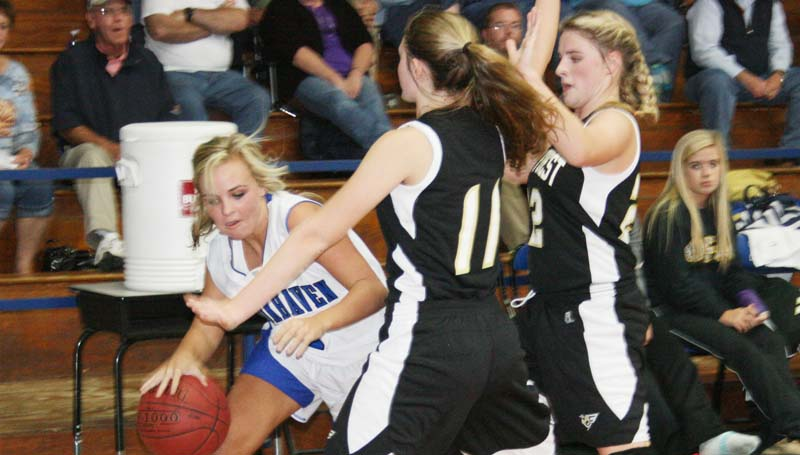 DAILY LEADER / MARTY ALBRIGHT / Brookhaven Academy's Hillary Wilson (4) tries to penetrate from the corner as Oak Forest defenders Payton Simmons (11) and Lindsey Neal (22) apply pressure Monday night.