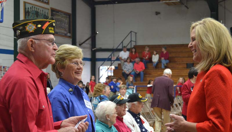 DAILY LEADER / RACHEL EIDE / Mississippi State Treasurer Lynn Fitch (right) talks with (from left) Korean War veteran Billy Hughes, commander of Post 2618 VFW, and his wife, Joyce Hughes, prior to the Brookhaven Academy Veterans Day program.