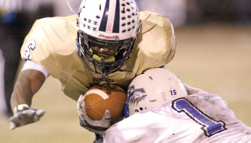 DAILY LEADER / JONATHON ALFORD / Bogue Chitto receiver Dennis Rogers (6) prepares to take a hard hit from French Camp defender Hagan Box (1) Friday night at Troy Smith Field.