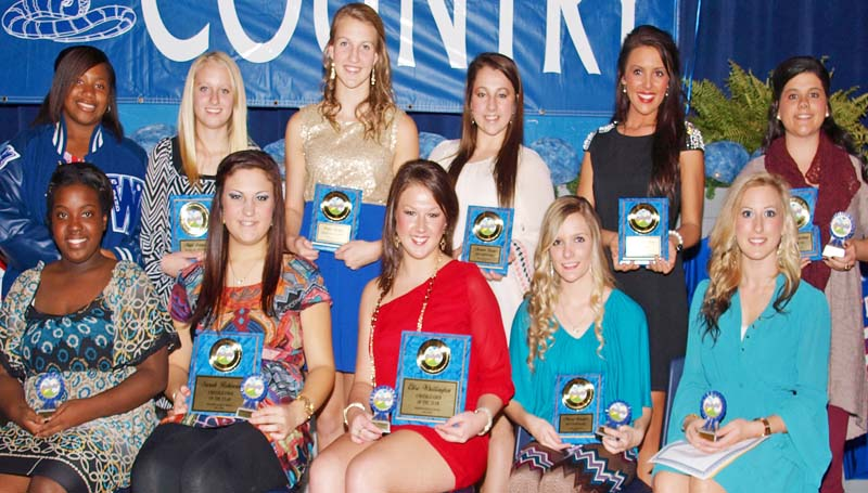 DAILY LEADER / TRACY FISCHER / The Wesson cheerleading squad was honored during the Cobras fall athletic banquet. Players receiving awards were (seated, from left) Olivia Barlow - senior; Sarah Robinson - Cheerleader of the Year, senior; Elise Whittington - Cheerleader of the Year, senior; Macey Granger - Most Dependable, Senior; Calah Channell - senior, (standing, from left) Gabrielle Thomas - senior; Maya Granger - Rookie of the Year; Anna Speights - Heart of a Champion; Morgan Boone - Most Dependable; Brittany Moore - 110 Percent Award, Sylvia Grantham - Most Improved, senior.
