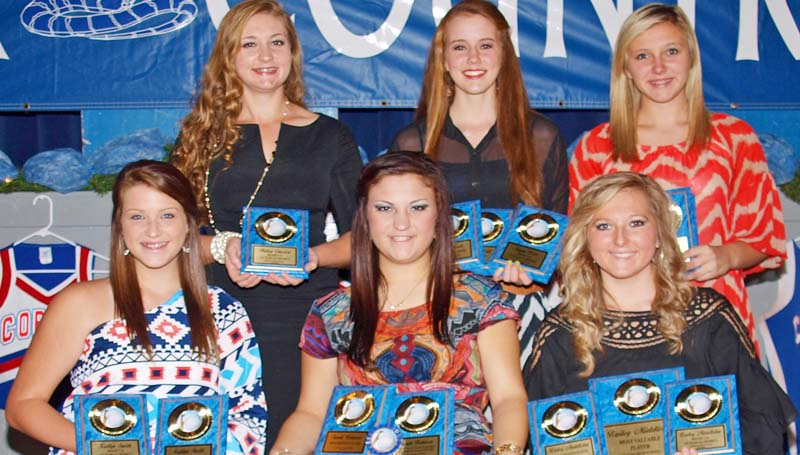 DAILY LEADER / TRACY FISCHER / The Wesson slowpitch softball team was honored during the Cobras fall athletic banquet. Players receiving awards were (seated, from left) Kaitlyn Smith - Best Offensive Player, Region 7 3A 1st Team All District; Sarah Robinson- Best Defensive Player, Region 7 3A 1st Team All District, MAC Slowpitch Allstar Game, Senior; Bailey Middleton - Best Offensive Player, MOST VALUABLE PLAYER, Region 7 3A 1st Team All District, Senior. (standing, from left) Hailey Chassion - Region 7 3A 1st Team All District; Kayla Britt - Hustle Award, Most Versatile Award, Region 7 3A 1st Team All District; Harmoni Ashley - Most Improved Player, Region 7 3A 1st Team All District.