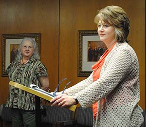 DAILY LEADER / JUSTIN VICORY / Rita Goss, tax assessor/collector for Lincoln County (from right), praises the hard work of Becky Dixon who has worked in the county tax office for more 27 years. Goss spoke to the board of supervisors at the board's Monday meeting.