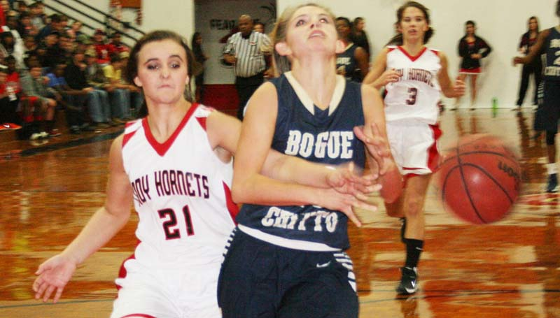 DAILY LEADER / MARTY ALBRIGHT / Bogue Chitto's Mattie Avants (10) drives in for a layup, but Loyd Star defender Marcie Givens (21) hustles in from behind to knock the ball away Tuesday night at Loyd Star gymnasium.