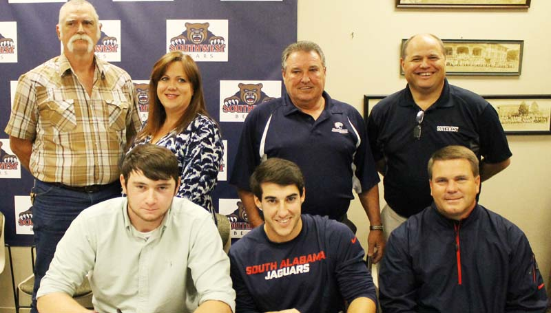 SOUTHWEST MEDIA / MICHAEL GUNNELL / Present for the early signing day for baseball were (front, left) Jesse Travis, Shane McKinley, Southwest head coach Lee Kuyrkendall, (Back) William Travis, Rhonda Travis, Dennis McKinley and Southwest assistant coach Ken Jackson.