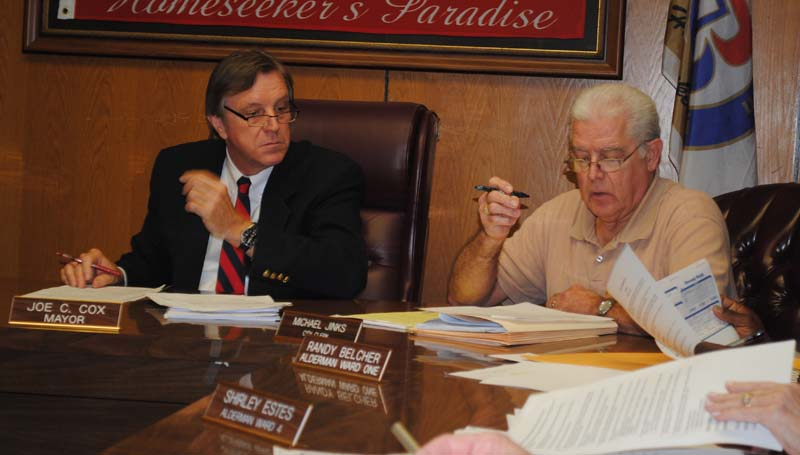 THE DAILY LEADER / JUSTIN VICORY / Mayor Joe Cox and City Clerk Mike Jinks contemplate the closure of a section of South Washington Street during discussion of the matter at Tuesday night's board of aldermen's meeting.
